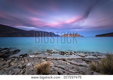View of the island of Spinalonga at sunset with nice clouds and calm sea. Here were isolated lepers, humans with the Hansen's desease and took place the story of Victoria 's Hislop novel