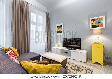 Living Room With Yellow Cabinet