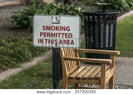 Designated smoking area Outdoor bench in smoking zone permitted