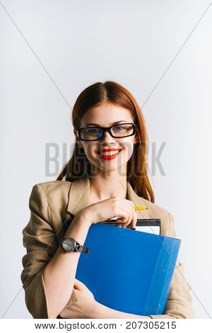 smiling secretary girl holding files and folders in hands