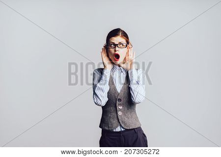 surprised secretary girl holding herself by the head
