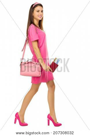 Young woman in pink dress isolated
