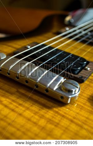 Abstract guitar photo, guitar strings, neck and pckups