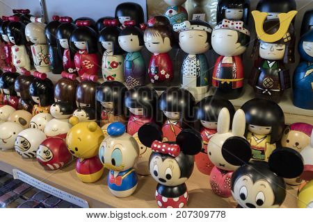 Kyoto - Japan, May18, 2017: Traditional wooden kokeshi dolls for sale as gifts or souvenirs