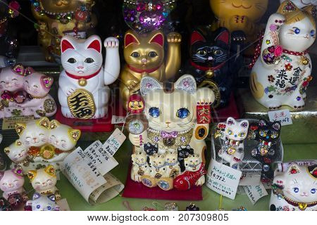 Kyoto, Japan - May 18, 2017: Variety of traditional Manekineko, lucky cats as a souvenir or gift