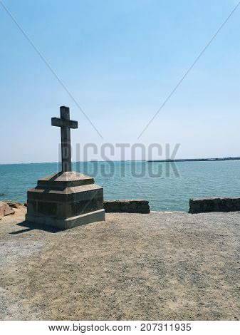 stone cross at the entrance of crossing of Gois, Noirmoutier island, France