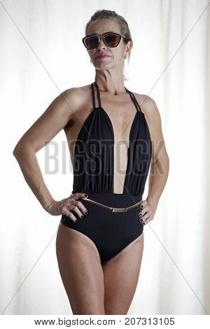Approximately 50 year old woman in a beach swimsuit