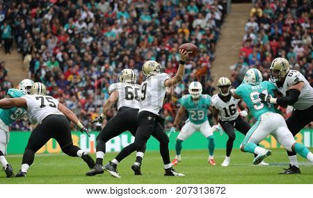 LONDON, ENGLAND - OCTOBER 01 2017: New Orleans Saints quarterback Drew Brees (9) throws a pass during the NFL match between the Miami Dolphins and the New Orleans Saints at Wembley Stadium