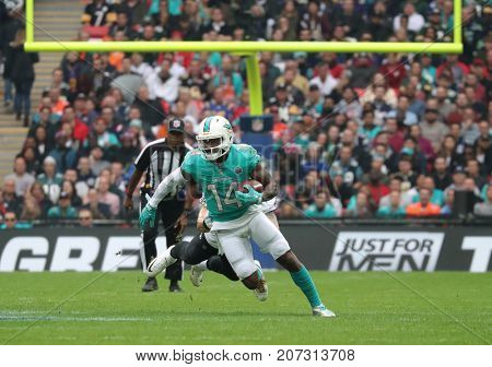 LONDON, ENGLAND - OCTOBER 01 2017: Miami Dolphins wide receiver Jarvis Landry (14) runs with the ball during the NFL match between the Miami Dolphins and the New Orleans Saints at Wembley Stadium