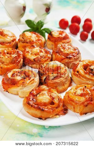 Fresh home made pizza rolls with mozzarella cheese and tomato sauce