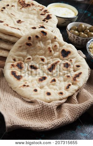 Fresh home made pita bread, flatbread popular in turkish, lebanese and other oriental cuisines