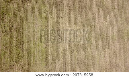 Aerial photo over ploughed dirt field