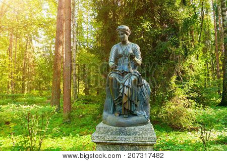 PAVLOVSK ST PETERSBURG RUSSIA - SEPTEMBER 21 2017. Bronze sculpture of Euterpe -the muse of music and eloquence with a scroll in her hand. Old Silvia park in Pavlovsk St Petersburg Russia