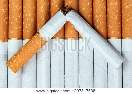 Broken cigarette. Focus on broke.
