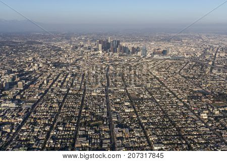Afternoon aerial view of urban streets and buildings west of downtown Los Angeles in Southern California..