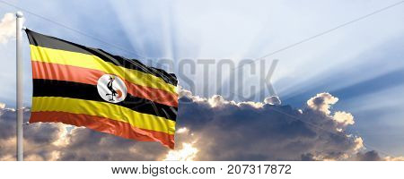 Uganda waving flag on blue sky. 3d illustration