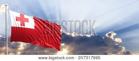 Tonga waving flag on blue sky. 3d illustration