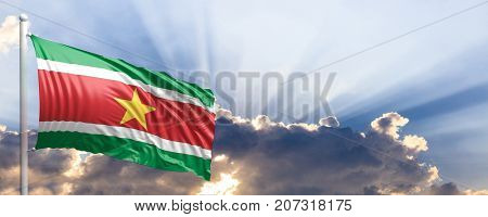 Suriname waving flag on blue sky. 3d illustration