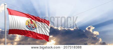 French Polynesia waving flag on blue sky. 3d illustration