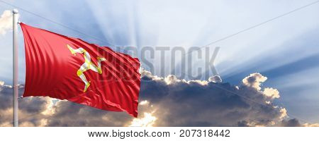 Isle of Man waving flag on blue sky. 3d illustration