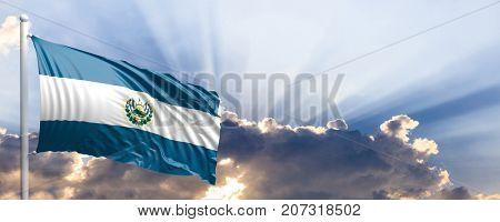 El Salvador waving flag on blue sky. 3d illustration