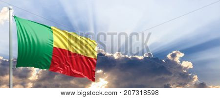 Benin waving flag on blue sky. 3d illustration