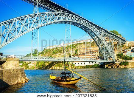 bridge of Dom Luis I at sunny day in old Porto, Portugal, retro toned