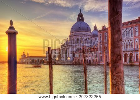 Beautiful sunrise in Grand canal with Church of Santa Maria della Salute, Venice, Italy, European Union. Famous historical heritage.