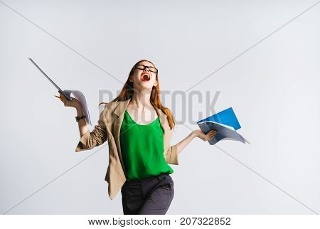 girl secretary laughing holding files and folders in her hands