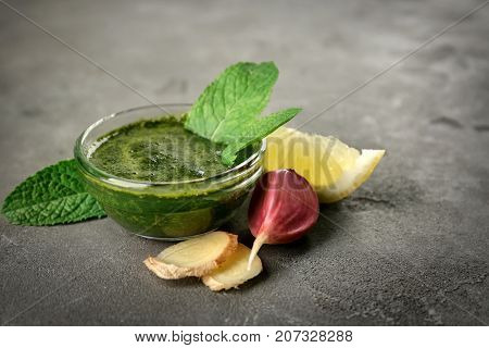 Gravy boat with chutney mint sauce on table