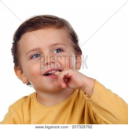 Adorable small child two years old sucking his hand