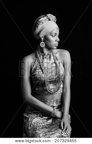 African black young woman beauty portrait with turban headscarf  in bw studio shot