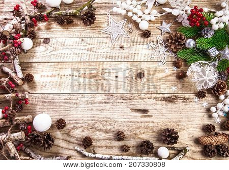Christmas holiday background with pinecone balls. Holiday greeting card branch old wooden board rustic style, copyspace and top view.