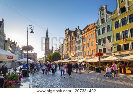 GDANSK, POLAND - AUGUST 14, 2017: People on the Long Lane street in old town of Gdansk, Poland. Baroque architecture of the Long Lane is one of the most notable tourist attractions of the city.