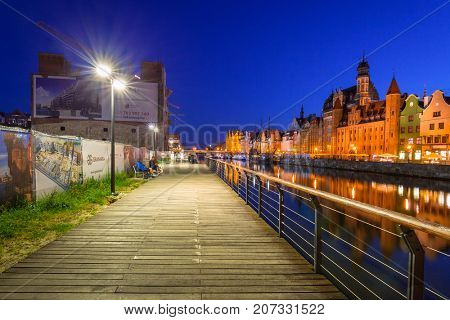 GDANSK, POLAND - AUGUST 14, 2017: Summer scenery of Motlawa river in Gdansk at night, Poland. Gdansk is the historical capital of Polish Pomerania.