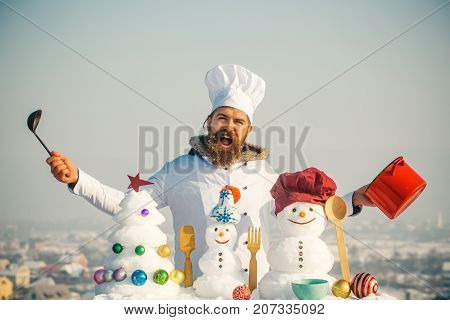 Man Shouting In Chef Hat And Uniform On Winter Day