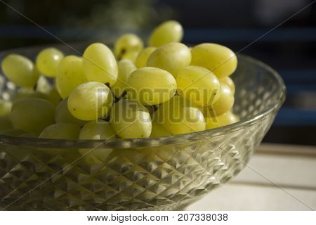 Sultana green Grapes on Glassy Dish close-up