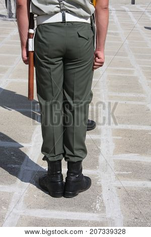 A soldier standing next to the Tomb of the Unknown Soldier. Memorial Day concept