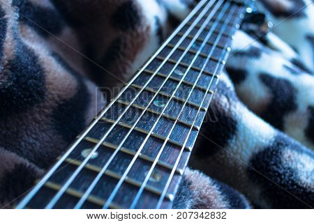 Abstract guitar photo, guitar strings, neck with blur