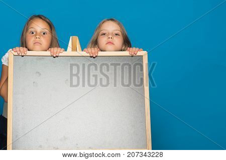 Children Stand Behind Blackboard, Copy Space. Education And School Concept