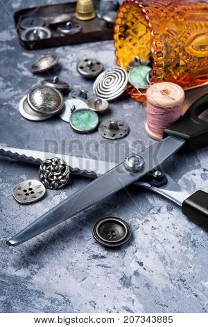 Fashionable buttons for clothes scissors and sewing threads.Copy space