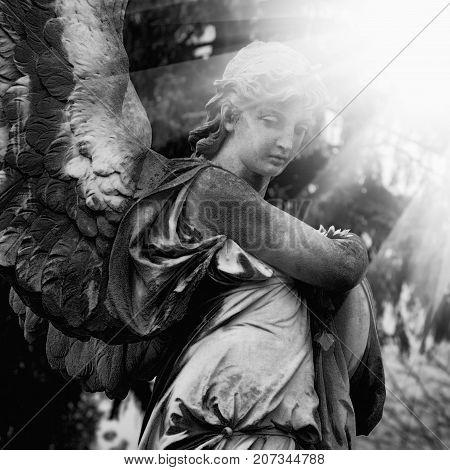 Guardian angel statue in sunlight as a symbol of strength truth and faith.