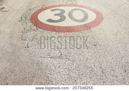 Color image on street of a 30km/h speed restriction