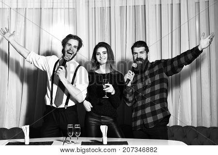 Happy Friends Celebrating At Karaoke Party