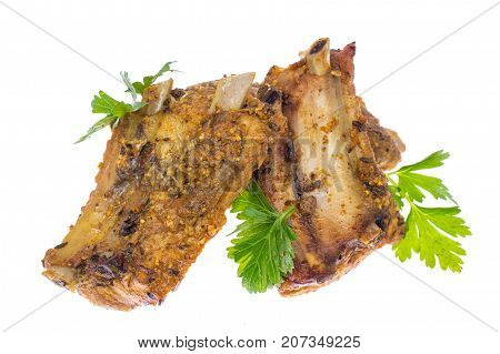 Grilled meat ribs with spices on white. Studio Photo