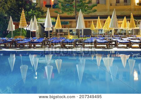 Alanya, Turkey -  August 14, 2017: Swimming pool in resort at night. Territory of tropical hotel with pool at night.