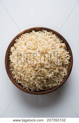 Stock Photo of cooked Brown Basmati rice served in a bowl, selective focus