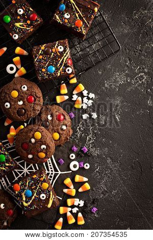Chocolate monster brownies with candy and sprinkles, homemade treats for Halloween overhead shot with copyspace