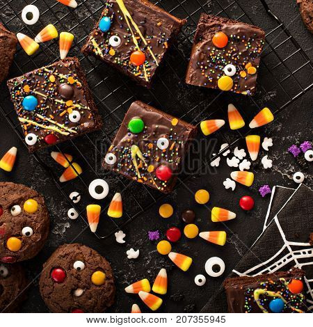 Chocolate monster brownies with candy and sprinkles, homemade treats for Halloween overhead shot