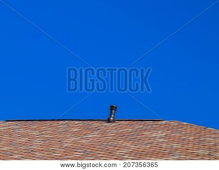 Roof From Multi-colored Bituminous Shingles. Patterned Bitumen Shingles. Ventilation On The Roof.